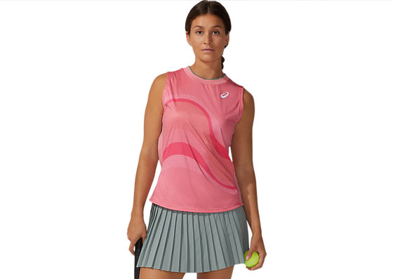Tennis player with a pink Asics tank top and a pleated skirt
