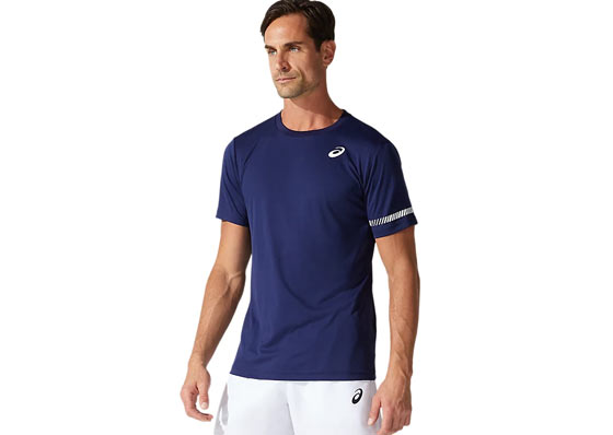 Tennis player with a blue Asics t-shirt and white Asics shorts