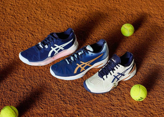 Asics tennis shoes on a court