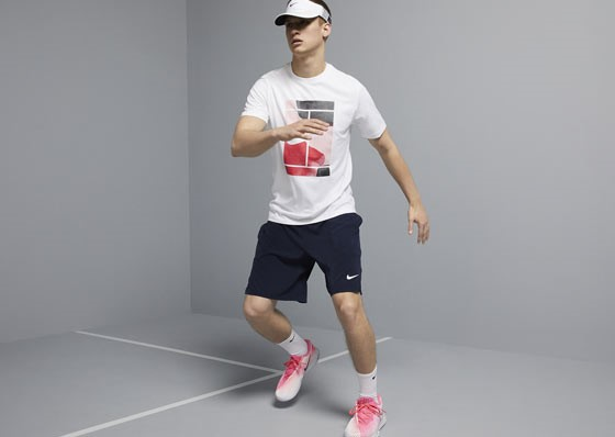 Model with shorts, t-shirt, cap and Nike shoes